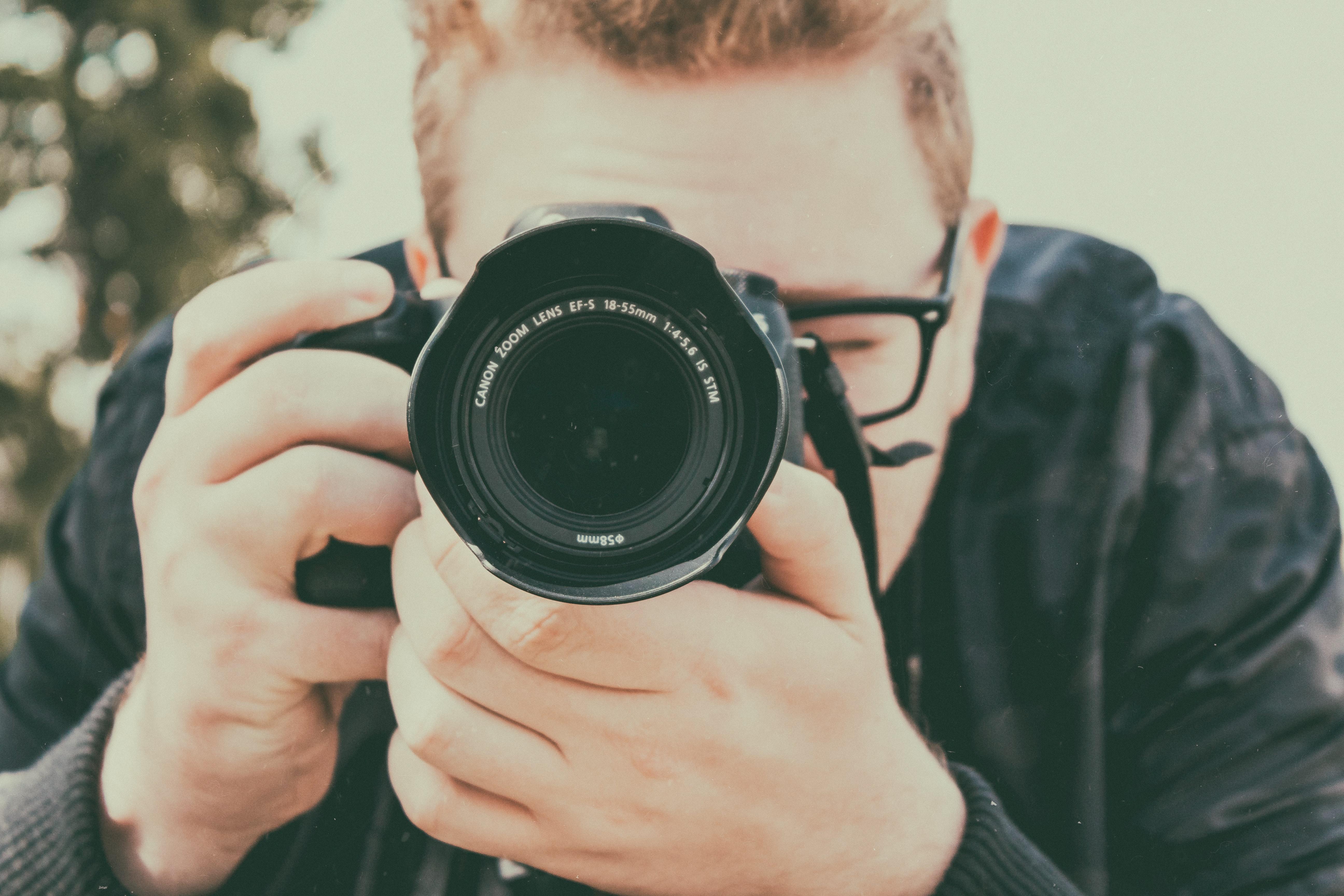 man takes photos